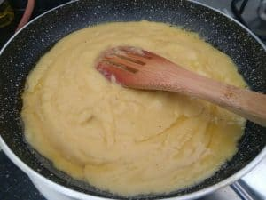 Cooking the Nendram banana puree with ghee