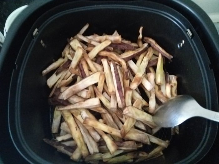 Toss the fries for even cooking