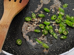 Saute the green chillies in ghee