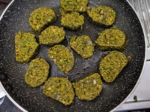 Pan frying the Kothimbir Vadi