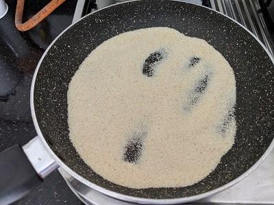 Roasting Rava until golden brown