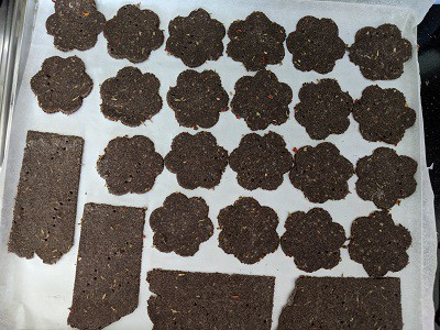 Crackers lined on a baking tray and ready to bake in the oven