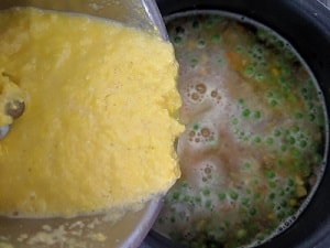 adding the sweet corn puree to thicken the soup