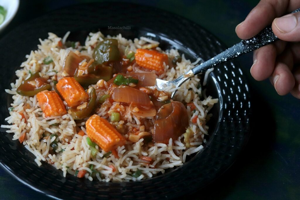 Vegetables in hot garlic sauce served with vegetable fried rice