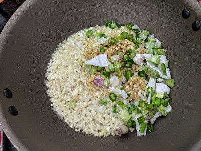 Garlic, Ginger, Spring Onions and Green chillies cooking in hot oil