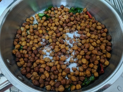 add the cooked chickpeas to the tempering with salt to taste