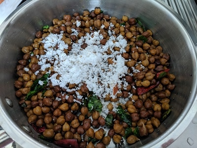 Freshly grated coconut is added to the chickpeas