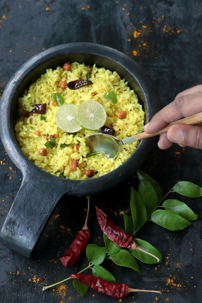 Lemon Rice - Tangy Rice recipe made with cooked rice, lemon juice and turmeric powder