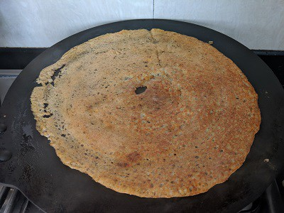 Dosa to be flipped and cooked on the other side.
