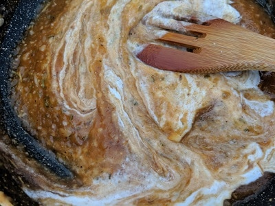 Adding the cashew paste to the pumpkin puree