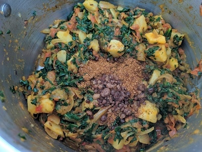 Jaggery powder and garam masala added to the sabzi as final touch