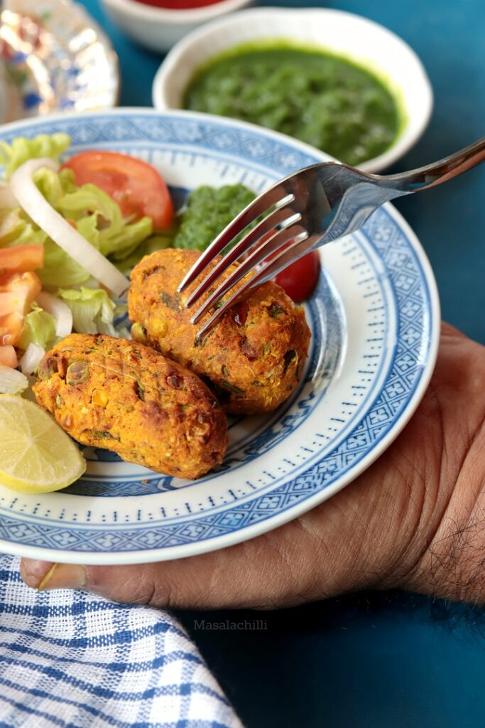 Veg Cutlets served with salad, chutney and tomato ketchup