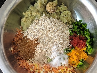 Spices, vegetables and oats for veg cutlet