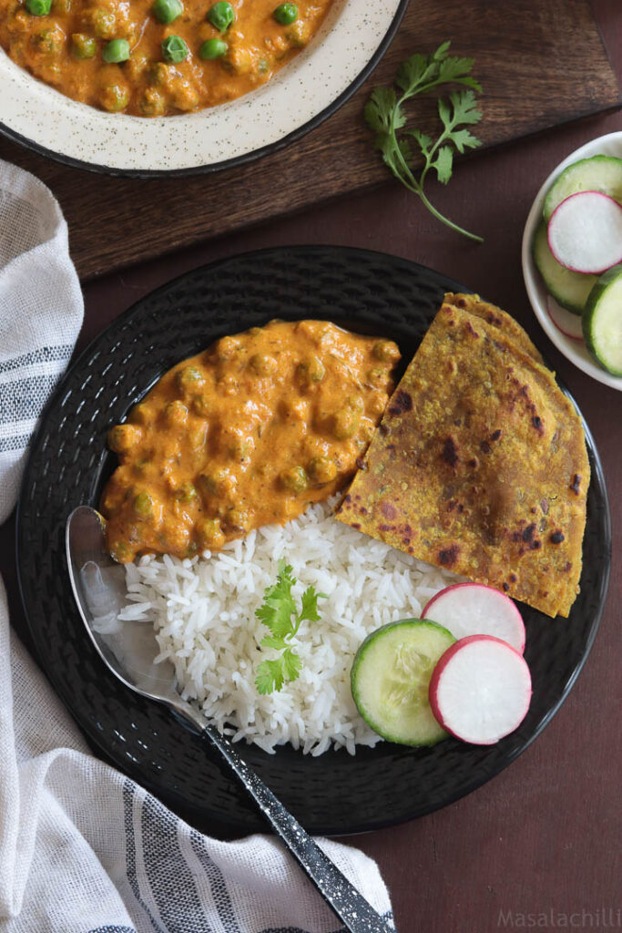 Vegan Green Peas Curry served with steamed rice, roti and salad